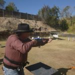 Cowboy shooting shotgun